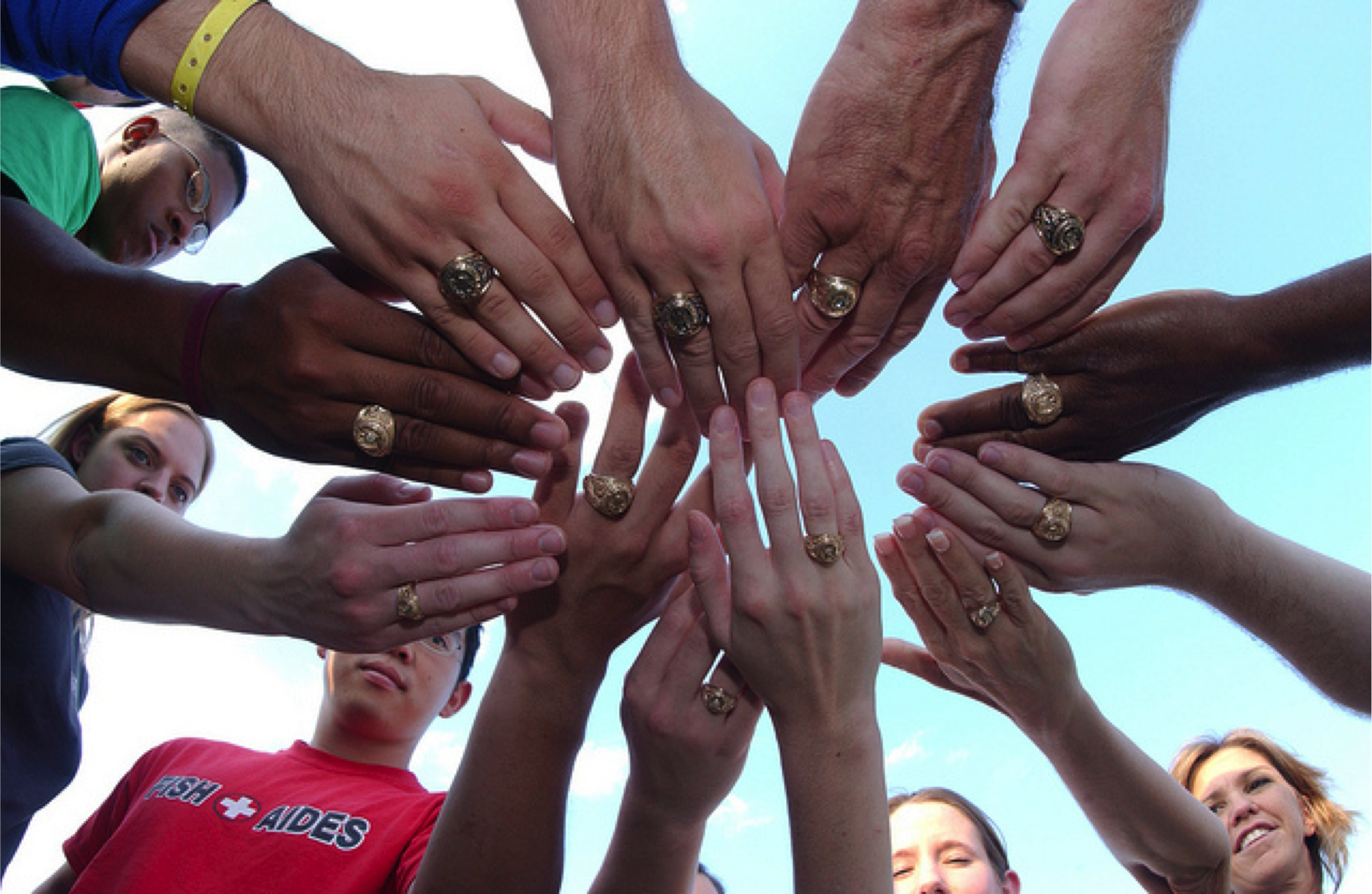 Aggie rings on hands in a circle